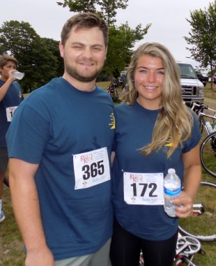 Evan Sutherland and Carolyn LaRosa, both of Somerville, follow the 14th Annual Reid's Ride to Fight Adolescent and Young Adult Cancer on July 15.