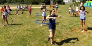 Children participating in a hula hoop competition during the Fourth of July festivities at Raddin Park.