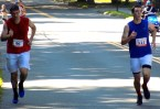 Sean Walsh, 37, of Middleton (left), and Andrew Moriarty, 18, of Danvers, approach the finish line of the 51st Annual Fourth of July Road Race on Summer Street. Moriarty finished in fifth place with a time of 18:27 and Walsh finished in sixth place with a time of 18:31.