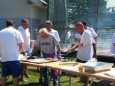A crew of neighborhood volunteers manned the grills at Devir Park.