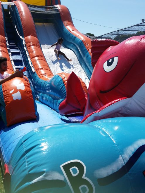 Kids cooled off on the huge inflatable water slides at different park events.
