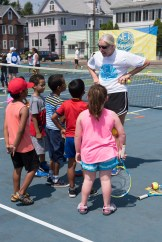 Instructor Kristen Liteplo from the United States Tennis Association spoke to a group of eager children about tennis on the court at Devir Park.