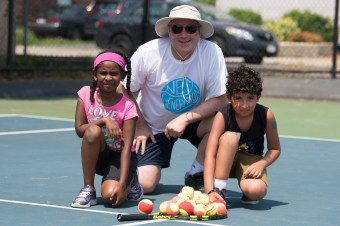 Miykal Sampson, instructor Woody Freeman, and Omar Elsayed learned about tennis on Tuesday in Malden.