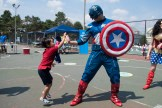 Jacob Zou leaped up to give Captain America a high-five at the Devir Park tennis court.