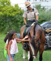 DCR Ranger Kristen Mincey introduces her horse, Cowboy, to some of the young participants in this year's National Night Out in Revere.