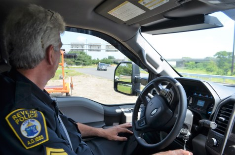 ON PATROL: Revere Police Sgt. Chris Giannino is shown observing traffic on Copeland Circle, one of the busiest roads in the city, which connects Rte. 60 with Route 1. (Advocate photo by Chris DeGusto)