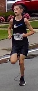 Aidan Kirby, 16, of Belmont, took third place during the Fourth Annual Mary O'Donnell 5K. He finished the race with a time of 18 minutes, 42 seconds. (Advocate Photos by Christopher Roberson)