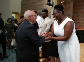 Assistant City Solicitor John McNaught congratulates Shataeya Smith, a member of Malden Rising Leaders's Summer Fellowship Program, on the group's presentation on lowering the voting age for Malden elections. The city's legal department helped the group draft a home rule petition to submit to the Malden City Council.