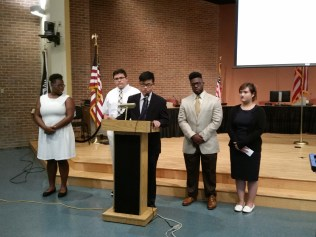 Shataeya Smith, Sean Lightbody, Jimmy Li, Wisly Pericles Jr., Vanessa Nguyen – members of Malden Rising Leaders' Summer Fellowship Program – present the results of their research on lowering the voting age to 16 in local elections.