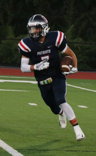 Jonathan Murphy takes the ball for a Patriot gain.