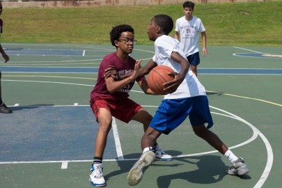 Tyrese Garcia and Caleb Awlachew took part in the 3-on-3 basketball tournament on Saturday.