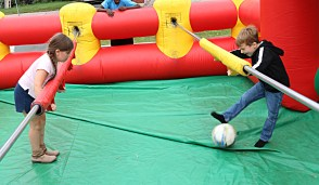 Elizabeth Barry tries to get one past Kyle Cash in the life size soccer game.