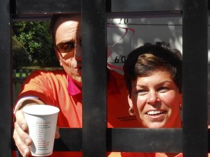 "RAISING ""Bail Money"": Saugus Public Schools Superintendent Dr. David DeRuosi, Jr. and Belmonte Middle School Principal Myra Monto solicit donations to get themselves freed from the Saugus BAND-Its Jail – and help the Saugus High School Band – at last year's Founders Day. (Saugus Advocate file photo by Mark E. Vogler)"