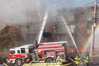 Firefighters battle a five-alarm blaze at 10 Franklin Ave. Sunday afternoon that devastated the apartment complex. (Advocate photo by Mike Lahey)