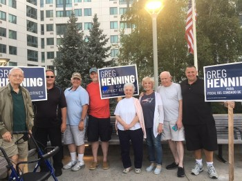 From left to right, Jerry Burman, Peter Martino, Hal Abrams, Michael Tucker, Ruth Burman, Mary MacDonald, Joe Cunningham and Steven Bottari campaign outside of Jack Satter House for Greg Henning for District Attorney, who won on the Democratic ballot, on Tuesday night.