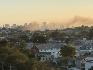 Smoke from the five-alarm fire at 10 Franklin Ave. was visible across the city.