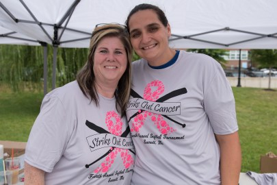 Kerri Shaefer and Tiffany Mulligan volunteered at the Strike Out Cancer softball game, selling shirts and goodies