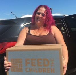 Revere resident Kristen Perez is organizing a similar effort, called Kristen Cares, to give back what she received. She received food and backpacks for her family during Thursday's event at Price Rite Marketplace.