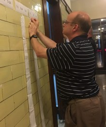 Warden Anthony LoRusso hung the results for Ward 6, Precinct 1, which covers St. Mary's Church on Washington Avenue, inside City Hall on Tuesday night.