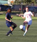 Kiley Ronan fights for position with a Patriot.