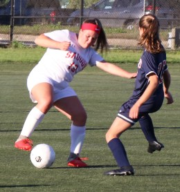 Jess Carter steals the ball.