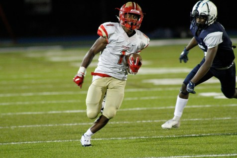 """Tide junior running back Jaden Mahabir, Coach Pierre's choice for the Everett Bank """"Offensive Player of the Week,"""" outruns a Lawrence defensive back for a touchdown in the Tide's 35-8 rout of Lawrence last Friday night. (Advocate photos by Mike Kearney)"""
