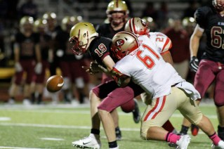 Outside linebacker and senior Captain Giovanni Raduazzo forces a fumble while tackling a BC High runner.