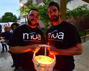 Marco Albanese and Josh McDonald pass out candles before the march.