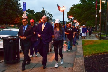 Paul Hammersley, Mayor Gary Christenson and Kasey Jordan lead the way on the march around the high school to kick off MOA's 4th Annual Candlelight Memorial Vigil.