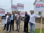 From left to right: Reading resident Domenic Bocchino, Daveen Arrigo, Mayor Brian Arrigo, Councillor-at-Large Tony Zambuto, Revere resident Bob Cronin and Milford resident Allen Green campaigned for Gov. Charlie Baker early Tuesday morning in front of St. Mary's Church.