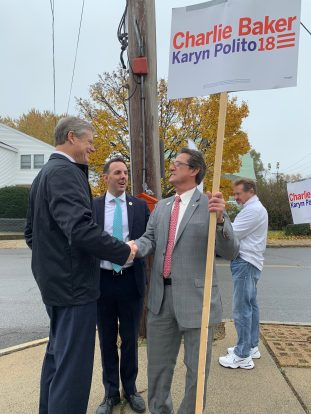 Councillor-at-Large Tony Zambuto shakes Gov. Charlie Baker's hand during his visit to the polls at St. Mary of the Assumption Church while Mayor Brian Arrigo looks on Tuesday morning.