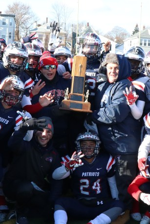 Coaches Lou Cicatelli and Vin Gregorio with the Patriots at Della Russo Stadium last Thanksgiving morning.