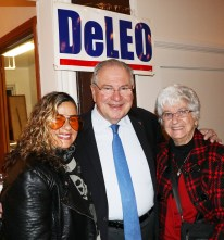 Mariah and Marie Giacobbe are greeted by Speaker Bob DeLeo.