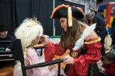 Giovanna Forsley added the finishing touches to children's costumes with a bit of face paint.
