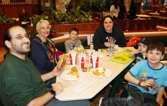 The Spadafora family enjoying lots of delicious Kelly's food for dinner.