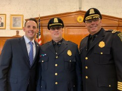 From left to right, Mayor Brian Arrigo, Police Sgt. John Cannon and Police Chief James Gudio are all smiles.