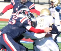 Captain Frank Simms on a tackle for the Patriots.