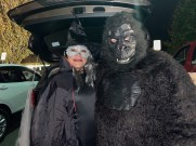 For Fright Night on Sunday at Rumney Marsh Academy, Councillor-at-Large George Rotondo was dressed up as a questionably scary gorilla; he is pictured with Ivette Mojica, who was a witch.