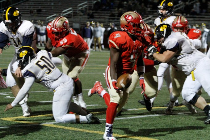 TIDE RUNNING BACK SENIOR Isaac Seide was a powerhouse on offense, shown scoring one of his three TDs behind some nifty blocking.