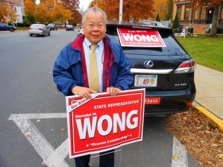 CAMPAIGNING AT SAUGUS CENTER: State Rep. Donald Wong campaigns Monday afternoon – the day before the election – outside Town Hall. The Saugus Republican won his fifth two-year term representing voters of the 9th Essex House District. (Saugus Advocate photos by Mark E. Vogler)