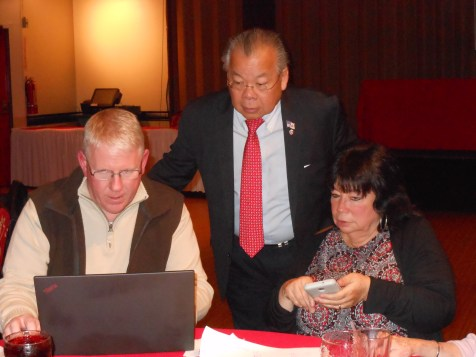 CHECKING THE NUMBERS: Left to right, Christopher Riley, State Rep. Donald Wong and Wong's campaign manager, Corinne Riley, tally up the poll results coming in from voting precincts in Lynn, Saugus and Wakefield on election night.