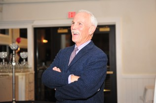 Randy Price laughs as Channel 5 staff congratulate him on his Appreciation Award.