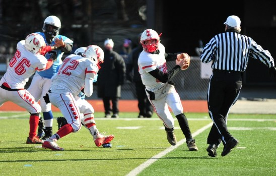 Saugus quarterback Mason Nickolas burst through an opening in the Tanners' defensive line. (Advocate photos by Laura Jolly)