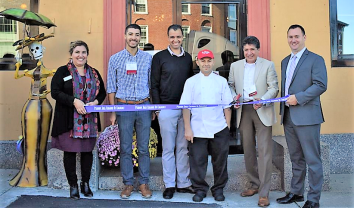 Jenna Coccimiglio, executive director of the Peabody Area Chamber of Commerce (far left) and Mayor Edward Bettencourt (far right) join, from right to left, Christopher Vasquez, Benjamin Morris, Jose Reyes, Martin Vasquez of La Siesta Restaurante to celebrate the grand opening of the Mexican eatery on Oct. 26. (Photos Courtesy of the Peabody Area Chamber of Commerce)