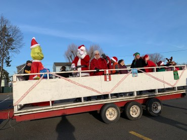 Mr. and Mrs. Claus wave to passersby as they kick off their Santa Walk at the High School on Saturday afternoon. (Advocate photos by Tara Vocino)