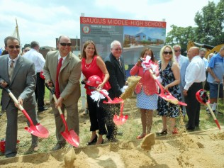 A MAJOR MILESTONE FOR EDUCATION: Town and state officials gather in July for the groundbreaking ceremony for the new Saugus Middle-High School construction project, which is targeted for opening in the fall of 2020. Local officials see the new school as a cornerstone to improving the town's public education system.
