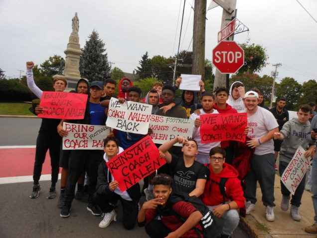 BACKING THEIR COACH: Members of the SHS football team picket at Saugus Center to show support for their head coach, Anthony Nalen, who was suspended as school officials investigated allegations that he forced a player to practice in his underwear.