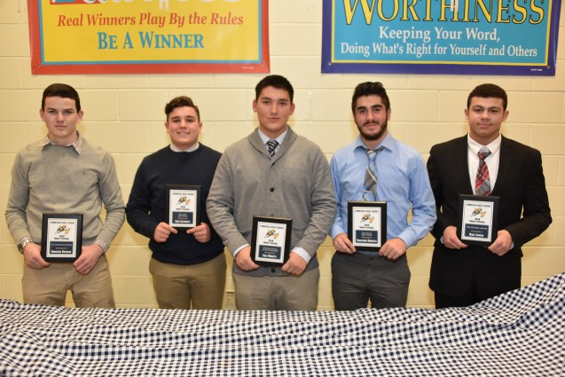 LHS 2018 Varsity Football The Commitment award winner Harrison Drislane, The 12th Man award winner Cory Castinetti, Defensive Player of the Year award winner Cole Moretti, Unsung Hero award winner Salvatore Marotta, and Courage Award winner Marc Cooper.