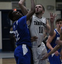 Peabody's Mike Tansey goes up hard for a rebound against the Falcons' Sherak Ayamga.