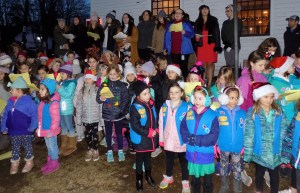 Girl Scouts joined the Lynnfield High School Tri-M Band to sing Christmas carols.